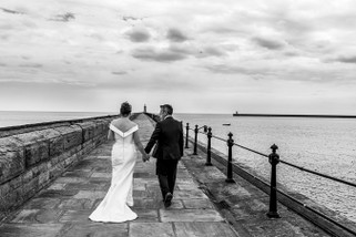 Bride and Groom Walking along Tynemouth Pier - North East Wedding Photographer.jpg