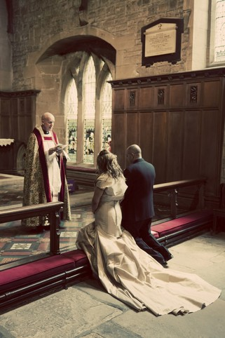 Bride and Groom with Vicar at Alter - North East Wedding Photographer.jpg