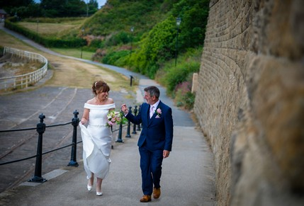 Bride and Groom joking while walking - North East Wedding Photographer.jpg