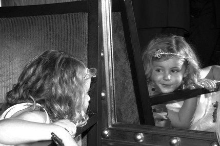 Cute bridemaid lookin at reflection in mirror - North East Wedding Photographer.jpg