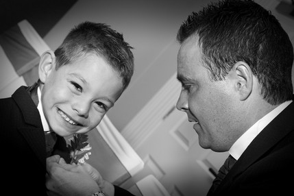 Groom fixing sons Buttonhole - North East Wedding Photographer.jpg
